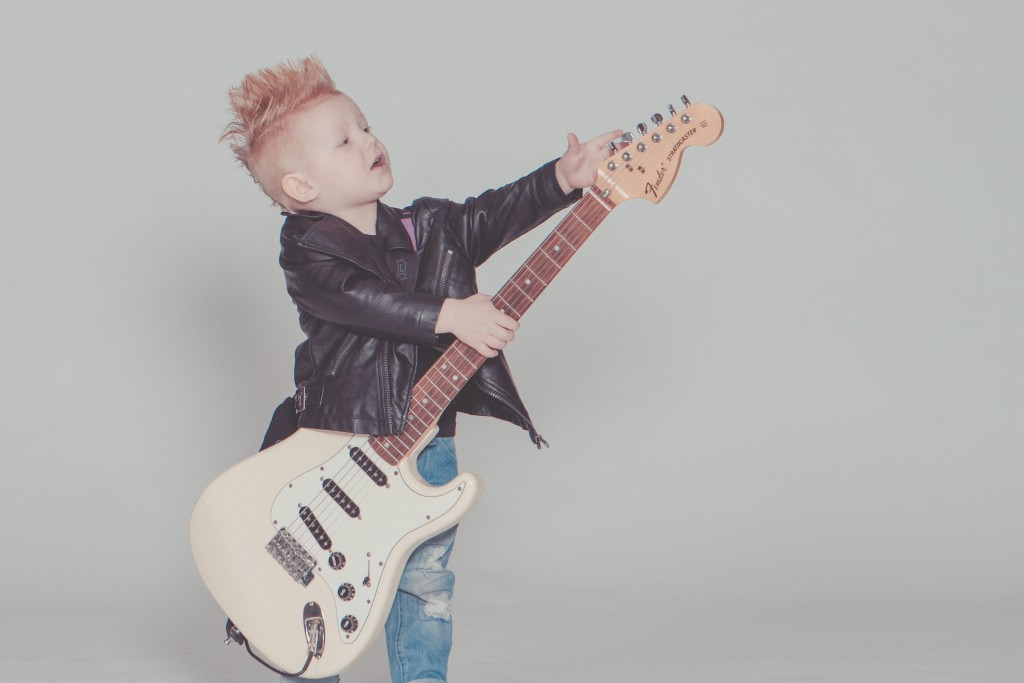 Boy Wearing Black Jacket Holding Electric Guitar 164835